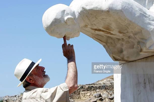 Italian artist Michelangelo Pistoletto checks the installation of his artwork 'La Caduta' at the archeological park of Scolacium on July 03 2010 in...