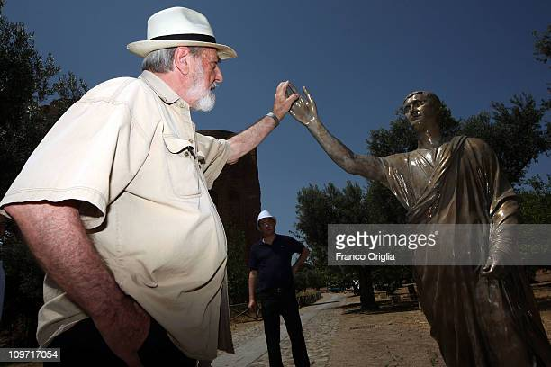 Italian artist Michelangelo Pistoletto checks the installation of his artwork 'L'Etrusco' at the archeological park of Scolacium on July 03 2010 in...
