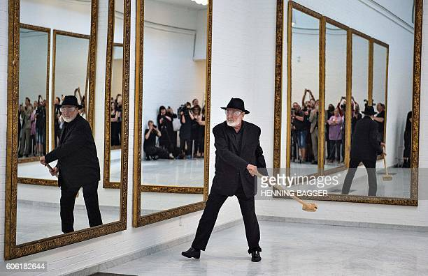 Italian artist Michelangelo Pistoletto performs with a hammer at the Aarlborg Art Museum on September 16 2016 During his performance Eleven Less One...
