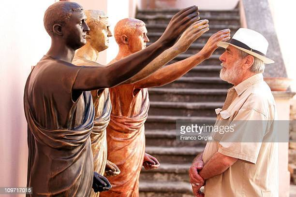 Italian artist Michelangelo Pistoletto poses in front his artwork 'Gli Etruschi' at the archeological park of Scolacium on July 03 2010 in Catanzaro...