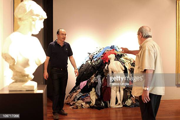 Italian artist Michelangelo Pistoletto sets his artwork 'Venere Degli Stracci' at the Catanzaro's Museum on July 03 2010 in Catanzaro Italy...