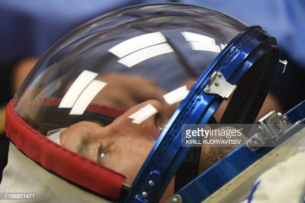 Italian astronaut Luca Parmitano of ESA a member of the International Space Station expedition 60/61 looks on as his spacesuit is tested prior to the...