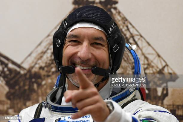 Italian astronaut Luca Parmitano of ESA a member of the International Space Station expedition 60/61 waves as his spacesuit is tested prior to the...