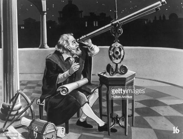 Italian astronomer and physicist, Galileo Galilei using a telescope, circa 1620.