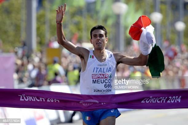 Italian athlete Daniele Meucci celebrates his victory as he crosses the finish line in the Men's Marathon during the European Athletics Championships...
