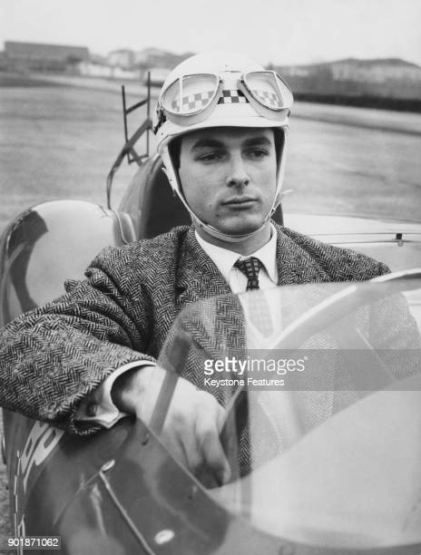 Italian athlete Livio Berruti winner of the 200meter dash at the 1960 Summer Olympics tries his hand at motor racing on the track at Modena Italy 1960