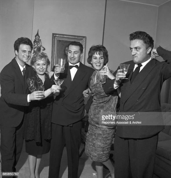 Italian ators Leopoldo Trieste Franco Interlenghi Giulietta Masina and Antonella Lualdi and Italian director Federico Fellini celebrating New Year's...