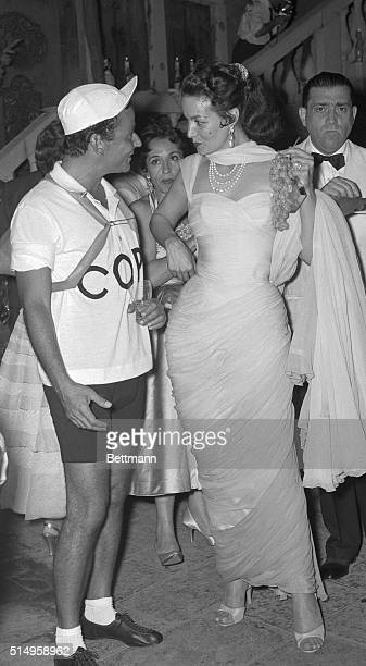 Italian author Pepi Lenzi and Mexican actress Maria Felix dressed as Italian cyclist Fausto Coppi and his girlfriend 'The White Lady' were among some...