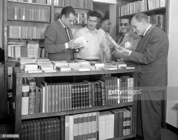 Italian authors Alberto Moravia Ennio Flaiano and Giuseppe Ungaretti at the 'Rossetti Library' in Via Veneto Rome 1948