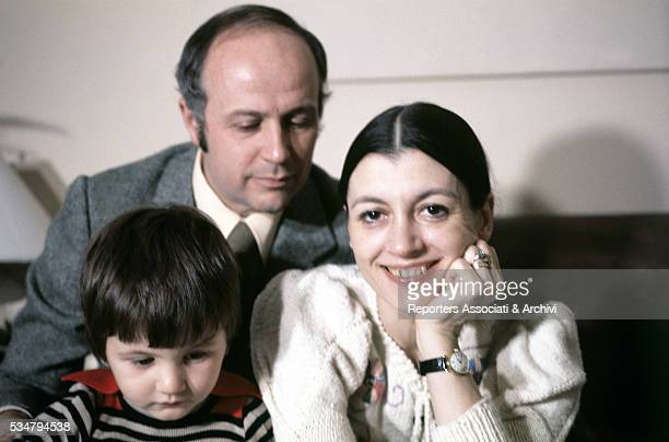Italian ballet dancer Carla Fracci smiling beside her husband and Italian theatre director Beppe Menegatti and their son Francesco 1976