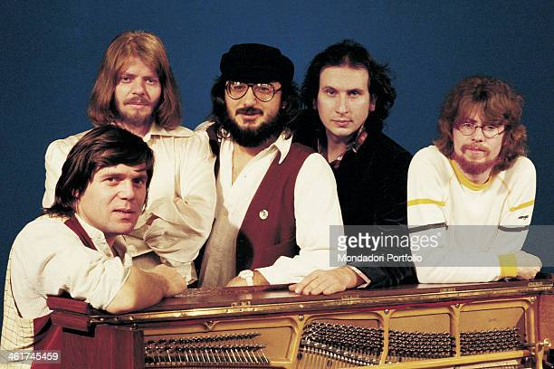 Italian band Nomadi leaning on a piano The band is composed by Italian singer Augusto Daolio Italian keyboard player Beppe Carletti Italian drummer...