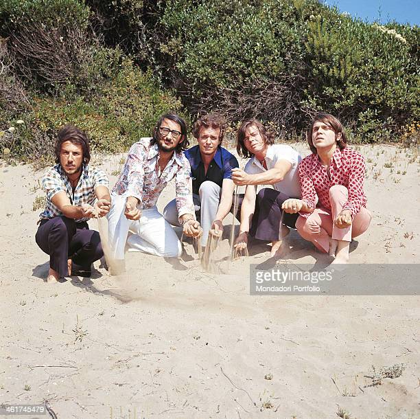 Italian band Nomadi playing with the sand The band is composed by Italian singer Augusto Daolio Italian keyboard player Beppe Carletti Italian...