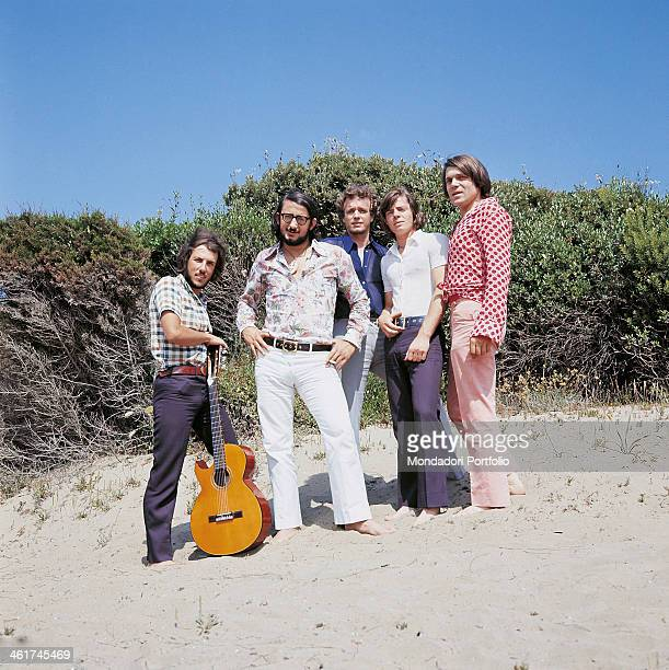 Italian band Nomadi posing keeping the feet in the sand The band is composed by Italian singer Augusto Daolio Italian keyboard player Beppe Carletti...