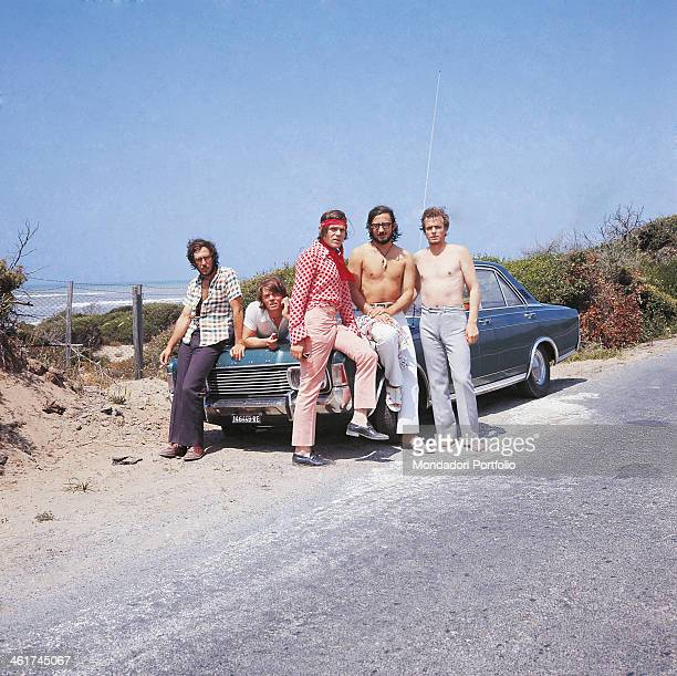 Italian band Nomadi posing leaned against a car The band is composed by Italian singer Augusto Daolio Italian keyboard player Beppe Carletti Italian...