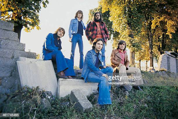 Italian band Nomadi posing seated on some stones The band is composed by Italian singer Augusto Daolio Italian keyboard player Beppe Carletti Italian...