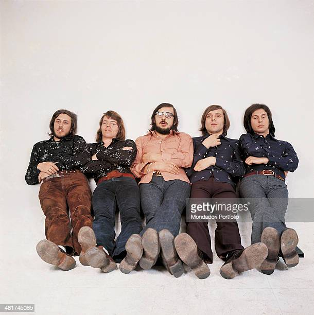 Italian band Nomadi posing sitting with folded arms on a photo set The band is composed by Italian singer Augusto Daolio Italian keyboard player...