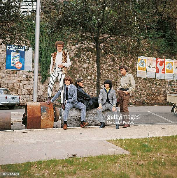Italian band Nomadi sitting in a parking lot The band is composed by Italian singer Augusto Daolio Italian keyboard player Beppe Carletti Italian...
