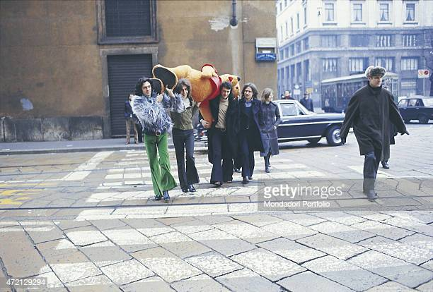 """""""Italian band Pooh carrying the bear Winnie the Pooh on the shoulders while crossing a street of the Lombard capital city. From the left: Riccardo..."""