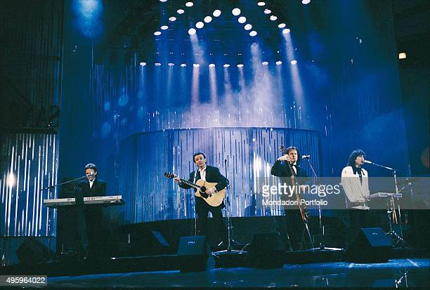 Italian band Pooh on stage at the 40th Sanremo Music Festival From the left Roby Facchinetti Dodi Battaglia Red Canzian and Stefano D'Orazio Sanremo...