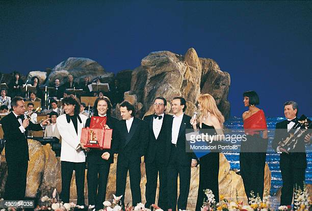 Italian band Pooh on stage during the award ceremony of the 40th Sanremo Music Festival From the left the Italian presenter Johnny Dorelli Stefano...