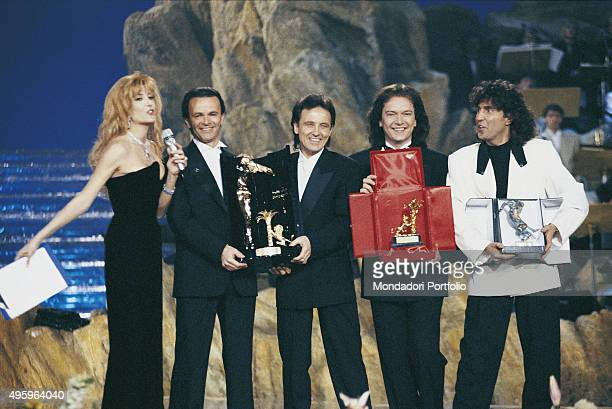 Italian band Pooh on stage with the Italian presenter Gabriella Carlucci during the award ceremony of the 40th Sanremo Music Festival From the left...
