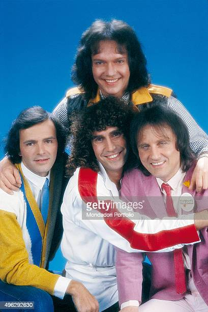 Italian band Pooh posing at the studio for a photocall From the left Dodi Battaglia Stefano D'Orazio Roby Facchinetti and Red Canzian above them...