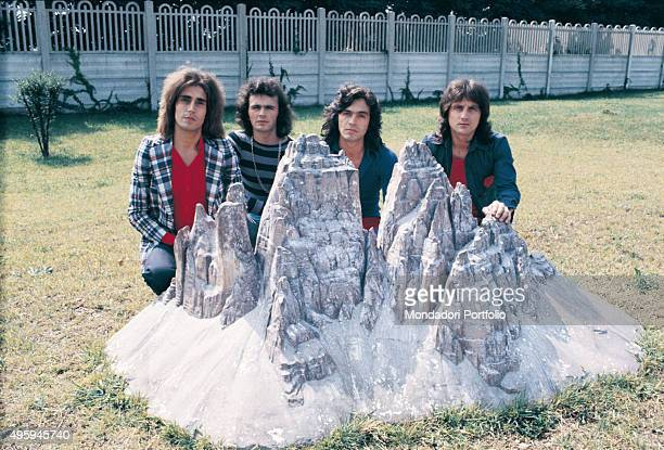 Italian band Pooh posing for a photo shoot behind a scale model of the Tre Cime di Lavaredo at the Italia in Miniatura park. From the left: Stefano...