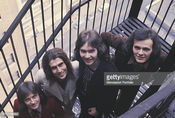 """Italian band Pooh posing for a photo shooting on a fire escape. From the left: Roby Facchinetti , Stefano D'Orazio, Red Canzian and Dodi Battaglia ...."