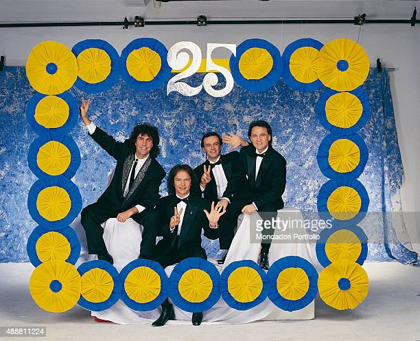 Italian band Pooh posing in a blue and yellow papiermache frame during a photo shoot realized on the occasion of the celebration of twenty five years...