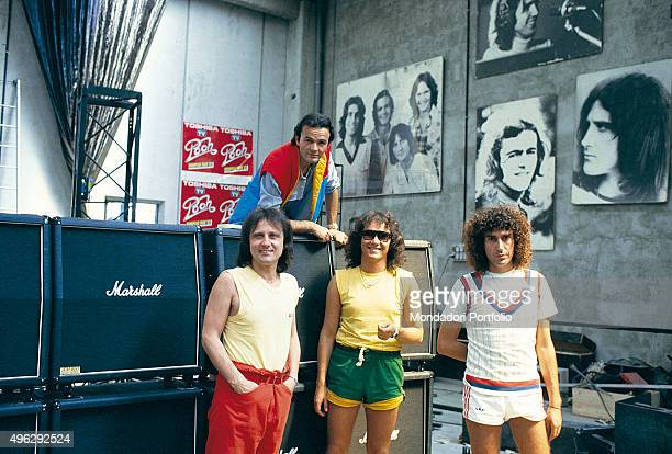 Italian band Pooh posing in the hangar where they rehearse for the summer tour From the left Roby Facchinetti Red Canzian and Stefano D'Orazio Above...