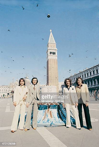 """""""Italian band Pooh posing on St Mark's Square beside a huge cake to celebrate ten years of music. Photo shooting. From the left: Roby Facchinetti ,..."""