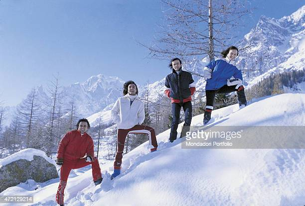 """""""Italian band Pooh posing on the slope of the snowy mountain for a photocall. From the left: Roby Facchinetti , Stefano D'Orazio, Dodi Battaglia and..."""