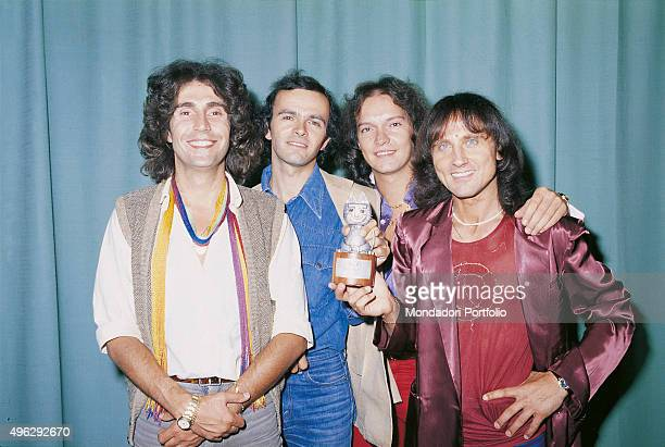 Italian band Pooh posing smiling with the third 'Vota la Voce' award From the left Stefano D'Orazio Dodi Battaglia Red Canzian and Roby Facchinetti...