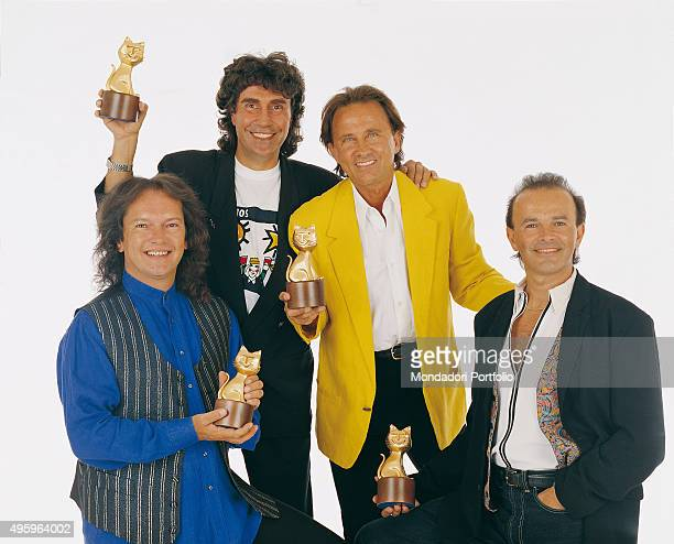 Italian band Pooh posing with their Telegatti during a photo shoot realized after their winning for the best tour at the 23rd Vota la Voce From the...