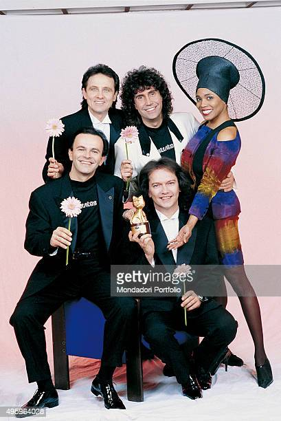 Italian band Pooh with a Telegatto posing with the American singer Dee Dee Bridgewater on the occasion of the 40th Sanremo Music Festival Photo shoot...