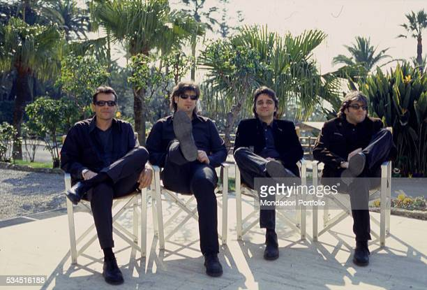 Italian band 'Stadio' posing sitting on some chairs in a garden From the left the drummer Giovanni Pezzoli the bass player Roberto Drovandi the...