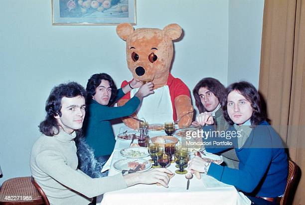 Italian band The Pooh feeding the bear Winnie the Pooh The band is formed by Italian drummer Stefano D'Orazio Italian keyboarder Roby Facchinetti...