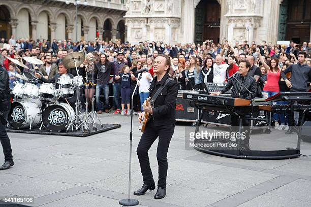 """Italian band The Pooh shooting unexpectedly the new videoclip for their song """"Chi fermerˆ la musica"""" in Piazza del Duomo, in front of thousands of..."""