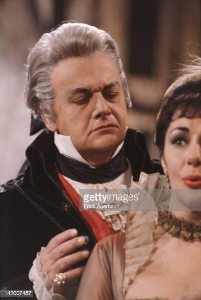 Italian baritone Tito Gobbi , as Scarpia, and Australian soprano Marie Collier as Floria Tosca in Puccini's opera 'Tosca', circa 1964.