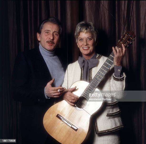 Italian baroness and singer Alida Valli playing Italian singersongwriter guitarist and actor Domenico Modugno's guitar 1981