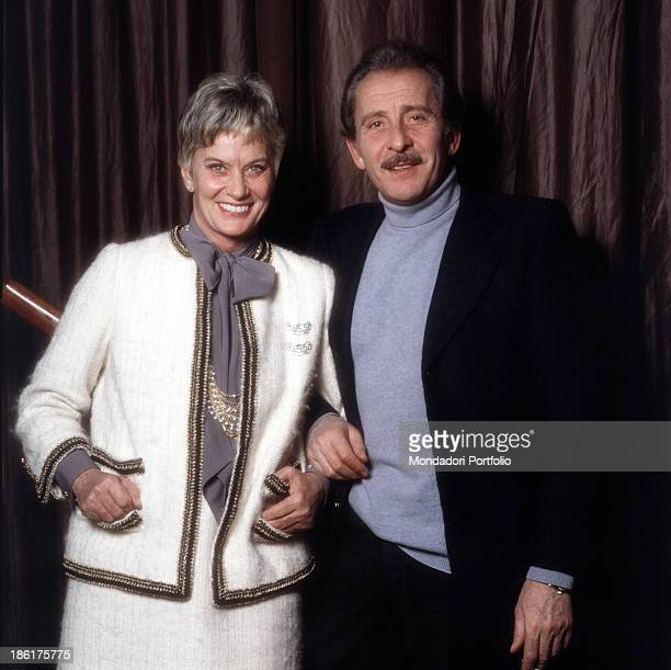 Italian baroness and singer Alida Valli smiling beside Italian singersongwriter guitarist and actor Domenico Modugno 1981