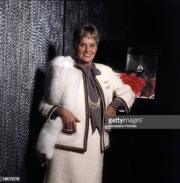 Italian baroness and singer Alida Valli wearing an elegant suit trimmed with a white fox fur scarf 1981