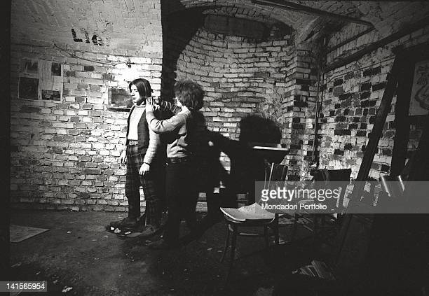 Italian beatnik combing a friend at Mondo Beat club in Milan Milan 1960s