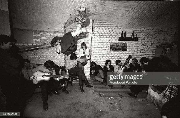 Italian beatniks having a rest and playing at Mondo Beat club in Milan Milan 1960s