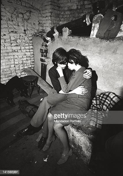 Italian beatniks hugging at Mondo Beat club in Milan Milan 1960s