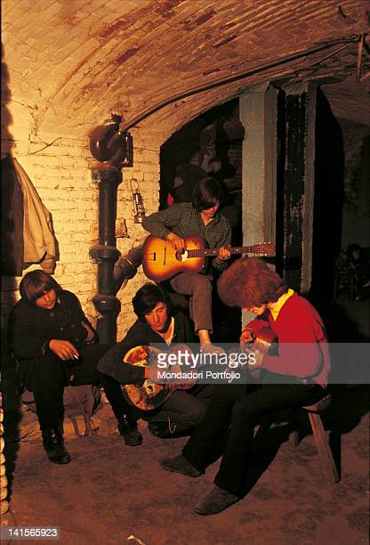 Italian beatniks playing guitar at Mondo Beat club in Milan Milan 1967