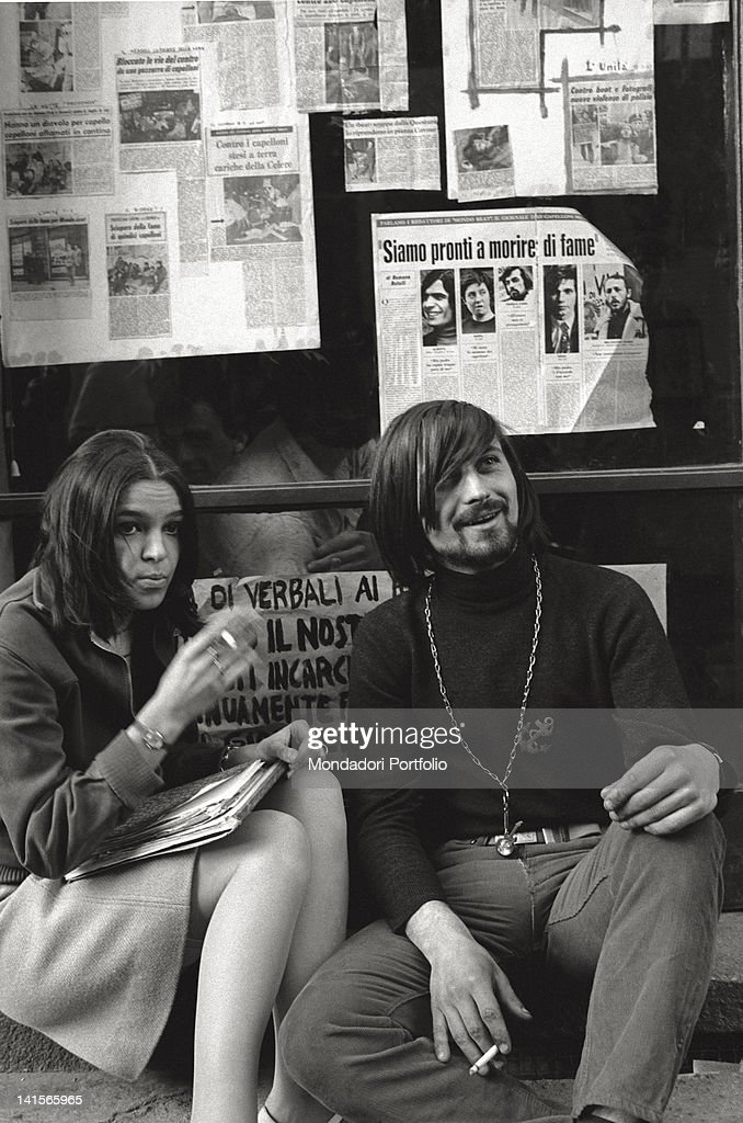 Beatniks In Front Of Signs : News Photo