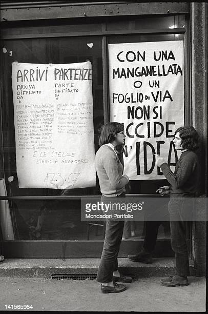 Italian beatniks talking in front of Mondo Beat club Milan 1960s