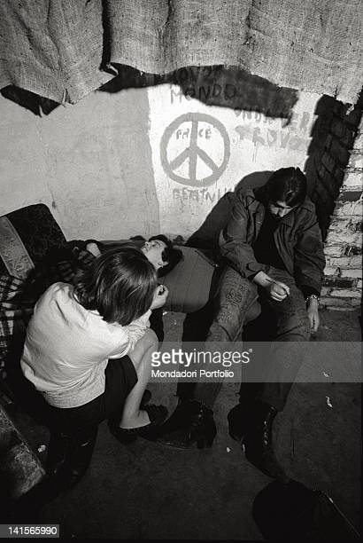 Italian beatniks writing on their clothes at Mondo Beat club in Milan Milan 1960s
