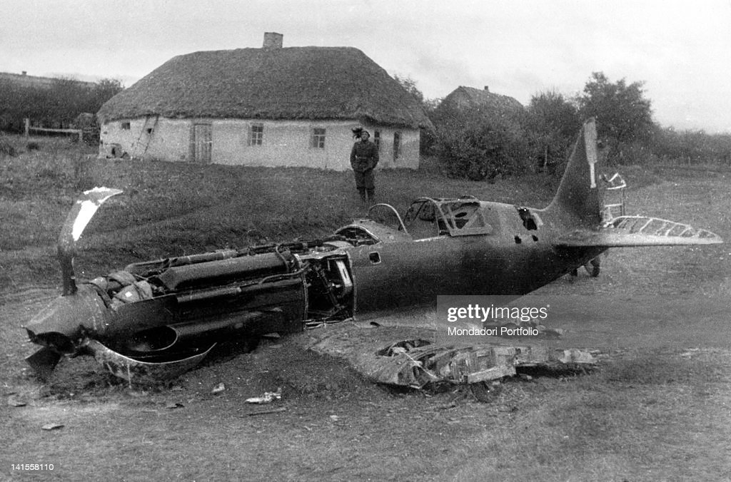 Soldier Beside The Wreck Of A Soviet Fighter Plane : News Photo
